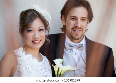 Beautiful happy Bride and Groom Mixed Ethnicity