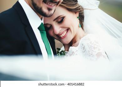Beautiful happy bride next to her groom