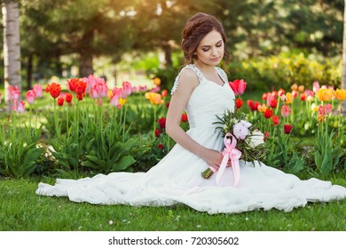 Beautiful Happy Bride outdoors in a park