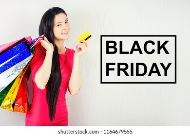 beautiful happy brunette female person with long hair shopaholic holding shopping bags . concept of shopaholism and sales black friday sale