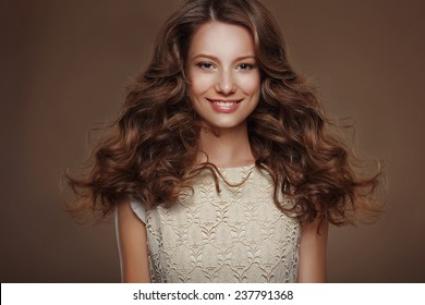 Beautiful Happy Brunette with Long Curly Hairs