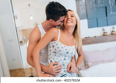 Beautiful happy couple in the morning after getting out of bed