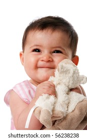 Beautiful happy cute baby girl smiling face with security blanket toy, isolated.