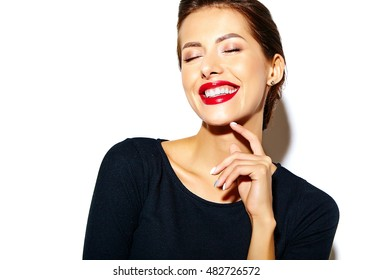 beautiful happy cute sexy brunette woman in casual black dress with red lips on white background