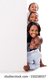 Beautiful happy family with a banner - isolated over white