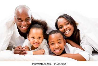 Beautiful happy family in bed - isolated over a white background