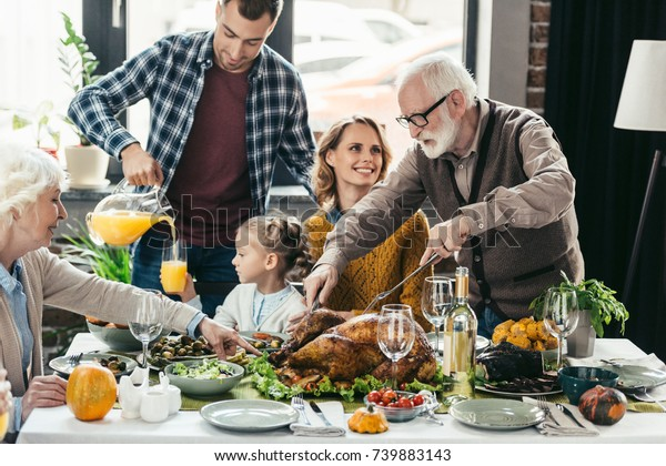 beautiful happy family celebrating thanksgiving day together