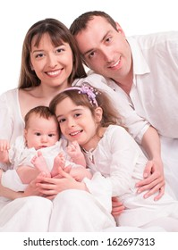 Beautiful happy family. Father, mother and children- isolated over a white background