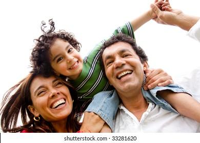 beautiful happy family having fun outdoors isolated