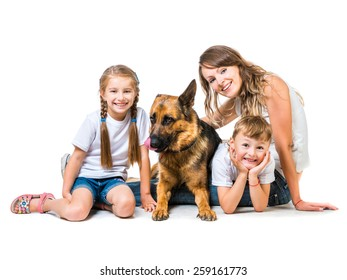 beautiful happy family:  mother with two children and their shepherd isolated on white