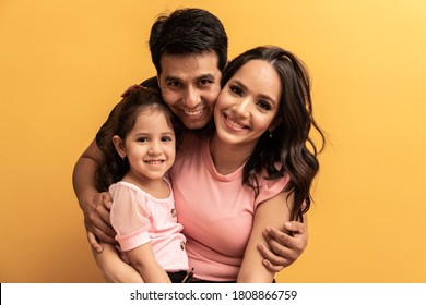 beautiful happy family on yellow background