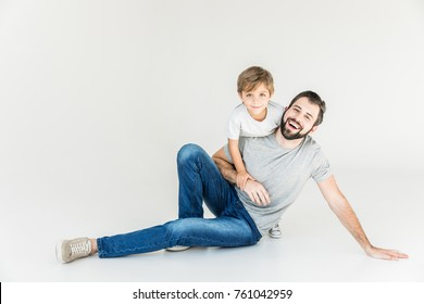 beautiful happy father and son having fun together and smiling at camera isolated on white