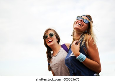 Beautiful happy friends laughing and smiling outdoors