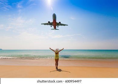 Beautiful happy fun woman and flying aircraft. Tropical blue sun sea. Luxury holiday resort. Island Phuket in Thailand. Impressive paradise. Hot beach Mai Khao. Amazing landscape unique