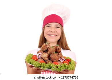 beautiful happy girl cook with meatballs on plate