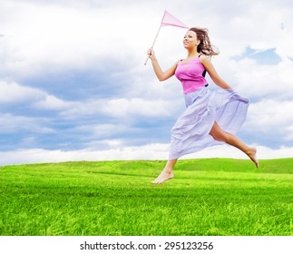 beautiful happy girl with a ring-net on a summer filed