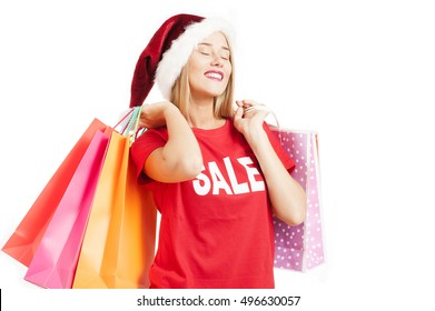 Beautiful Happy Girl with Shopping Bags. Christmas Sales