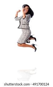 Beautiful happy jumping cheering business woman celebrating joyfully, on white.