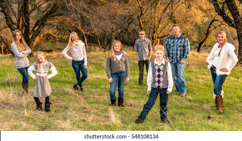 Beautiful Happy Large Family together smiling outdoors