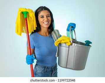 Beautiful happy latin woman holding cleaning equipment in Cleaning service Professional, housemaid and housework isolated on blue background.