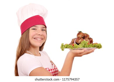 beautiful happy little girl cook with meatballs on plate