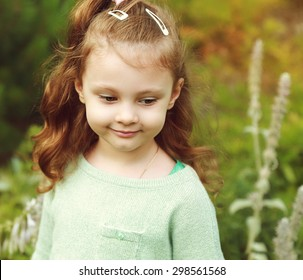 Beautiful happy long hair girl walking in the summer field with smile