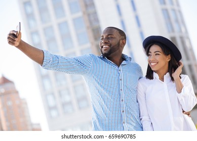 Beautiful happy modern couple posing for a selfie