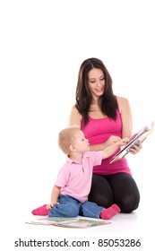 beautiful happy mother with child 2 years boy read book isolated on white
