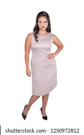 Beautiful happy plus size woman in pink dress isolated on white