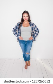 Beautiful happy plus size woman barefoot. Body positive concept