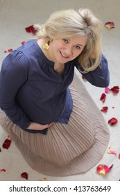 Beautiful happy pregnant woman with rose