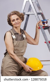 Beautiful and happy senior woman  worker posing