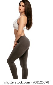 Beautiful happy slim young sporty fitness woman