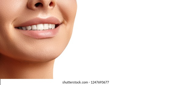 Beautiful Happy Smile of Young Woman on White Background. Perfect Healthy White Teeth. Dental Whitening, Ortodont, Care of Tooth, Tretment and Wellness
