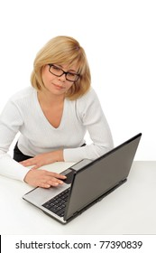 Beautiful happy and smiling business woman working on computer at her office against white wall wearing glasses