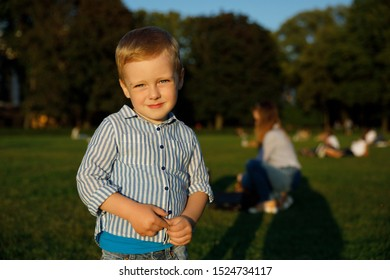 Beautiful happy smiling little boy. portrait of a happy child outdoors
