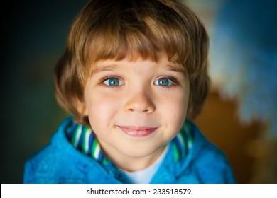 beautiful  happy smiling   little boy with a big blue eyes and long eyelashes amazing