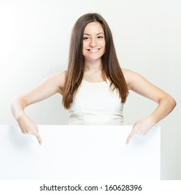 beautiful happy smiling woman hold white blank board
