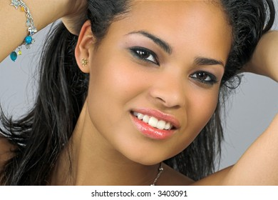 beautiful happy smiling woman playing with hair