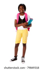 Beautiful happy student girl with colorful notebooks and backpack ready for school, isolated.