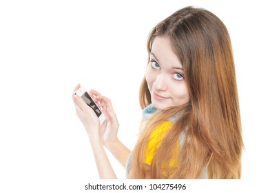 Beautiful and happy student girl standing isolated on white background. Smiling and looking into the camera. Casual style, modern smart phone in hands.