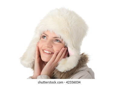 Beautiful happy teen girl with winter fake fur hat isolated on white background
