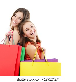 beautiful happy teen girls with colored shopping sale bags over white
