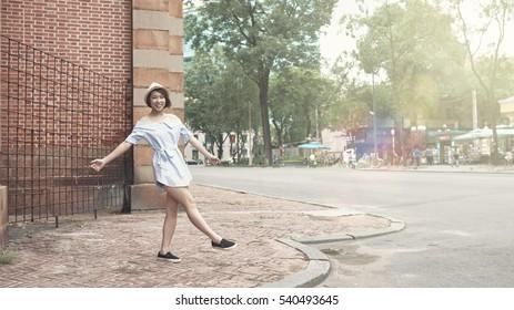 Beautiful happy Vietnamese woman standing in the street
