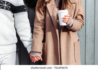 Beautiful happy winter christmas style couple have fun outdoor on the street