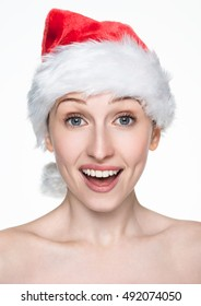 Beautiful happy woman in christmas santa hat. Happy emotion, surprised model young girl
