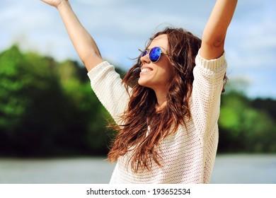 Beautiful happy woman enjoying freedom outdoors