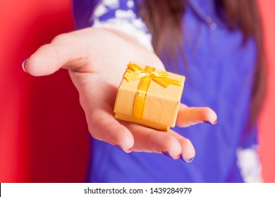 beautiful happy woman with gift box