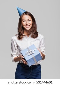 Beautiful happy woman with gift box at celebration party. Birthday or New Year eve celebrating concept