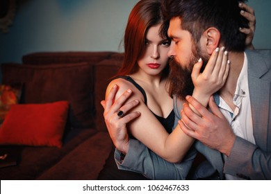Beautiful happy woman hugging man, grateful wife embracing caring loving husband thanking for help support, apology and forgiveness, empathy understanding in relationships concept, embracing on couch